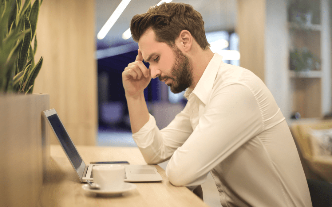 Man who is unhappy at work